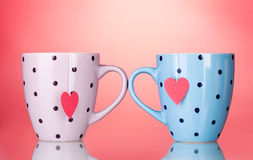 Two cups and tea bags with red heart-shaped label