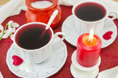 Two cups of tea and a burning candle Royalty Free Stock Photo
