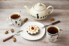 Two Cups of tea and cake  on the table Royalty Free Stock Photos