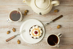 Two Cups of tea and cake  on the table Royalty Free Stock Photo