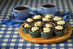 Two cups of tea and cakes on the table Royalty Free Stock Images