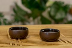 Two cups of tea on a Chinese table royalty free stock photo