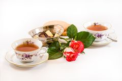 Two cups of tea with chocolates and cookies Stock Photos