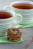 Two cups of tea and cookies Stock Photo