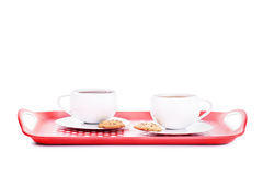 Two cups of tea with cookies on a platter. Isolated on white background Royalty Free Stock Photos