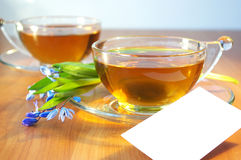 Two cups of tea and flowers Royalty Free Stock Photos