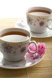 Two cups of tea and flowers Royalty Free Stock Images