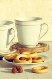 Two cups for tea with fragrant bagels Stock Photo