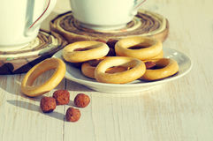 Two cups for tea with fragrant bagels Royalty Free Stock Images