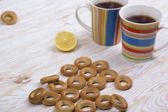 Two cups for tea with fragrant bagels on  wooden background Stock Photo