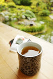 Tea in the garden. Two cups of tea in the garden Royalty Free Stock Photography