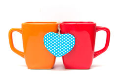 Two cups of tea with heart shape isolated on white. Stock Photo