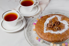 Two cups of tea and homemade cake. Closeup Stock Photos