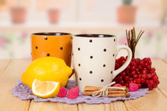 Two cups of tea with lemon, cranberry Stock Image