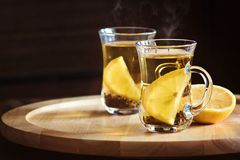 Two cups of tea and lemon slices closeup on wooden background with place for your text Stock Photo