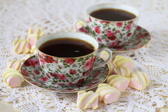 Two cups of tea and marshmallow on a lace tablecloth. Closeup,selective focus Royalty Free Stock Photo