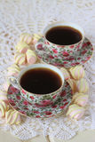Two cups of tea and marshmallow on a lace tablecloth. Closeup,selective focus Stock Photo