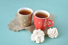 Two cups of tea with meringue cookiesground Stock Image