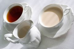 Two cups of tea and milk jug. Royalty Free Stock Photos