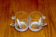 Two transparent cups with tea bags Stock Images