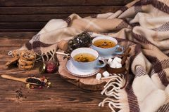 Two cups of tea with a plaid on the table. autumn is coming. warm background with tea and plaid stock photography