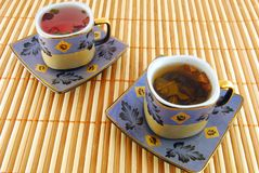 Two cups of tea on the rug. Two cups of tea on the striped rug stock images