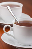 Two cups of tea with saucers Stock Photo