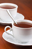 Two cups of tea with saucers Royalty Free Stock Photo