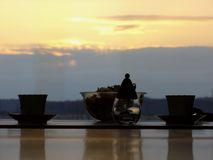 Two cups of tea in the sunset. A picture of peace and tranquility stock photos