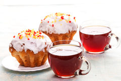 Cups of tea and muffins. Two cups of tea and two muffins on plates Royalty Free Stock Images