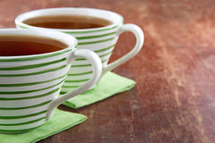 Two cups of tea on wooden background Stock Photo