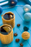 Two cups of tea in yellow Knitted sweaters on background Stock Photography