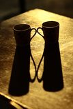 Two cups and their shadows on the table Royalty Free Stock Photos