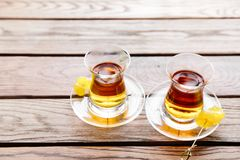 Two cups of traditional Turkish tea on a table in a street cafe in Istanbul, Turkey. Two cups of traditional Turkish tea on a table in a street cafe in Istanbul Royalty Free Stock Images