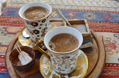 Two cups of Turkish coffee on a Persian rug Royalty Free Stock Images