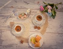 Two cups of Turkish coffee and a plate with baklava top view Stock Image