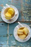 Two cups of Vanilla macaroons Stock Images