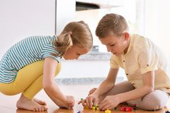 Two curious happy children playing with game Stock Images