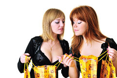 Two curious shopping girls Royalty Free Stock Photos