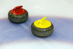 Two curling stone on Ice Stock Image