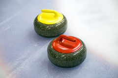 Two curling stone on Ice Stock Photo