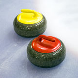 Two curling stone on Ice Royalty Free Stock Photography