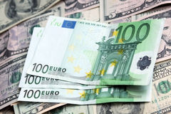 Two currencies - US Dollar and Euro Stock Photos
