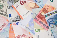 Two currencies - US Dollar and Euro Stock Photography