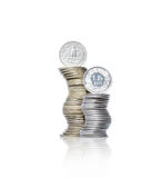 Two curved piles of yellow and white metal coins with dollar and Royalty Free Stock Photo