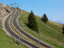 Two curved and steep railways in the mountains Stock Photos