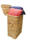Two Cushions in a cane Hamper Stock Images