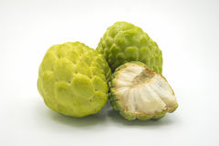 Two custard apples and one half custard apple, isolated on background.