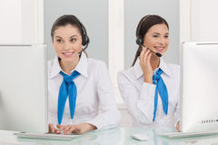 Two customer service representatives at work. Royalty Free Stock Photography