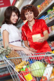 Two Customers In Supermarket. Stock Photo